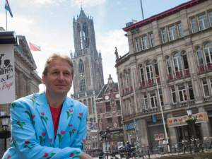 Patrick in Utrecht with the Dom tower on the background
