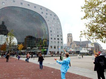 Modern Markthal and Laurens church, damaged in the war