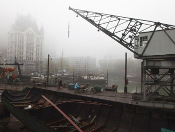 The Old Harbor with white house in early morning fog