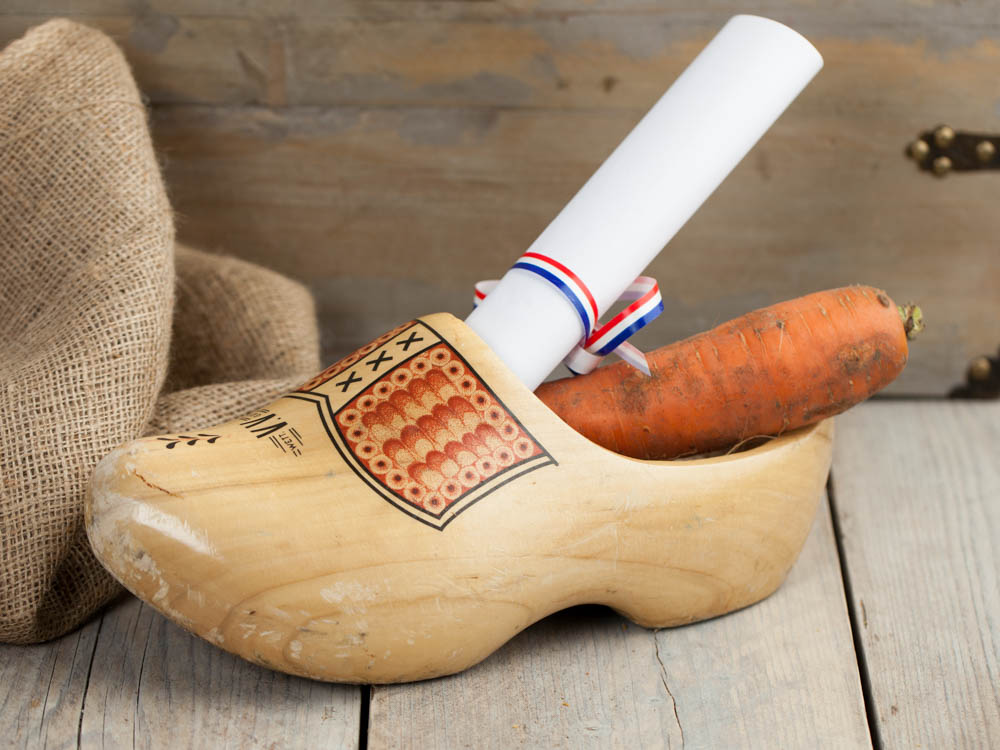 A wooden shoe filled with a drawing and a carrot for Sinterklaas and his horse Amerigo