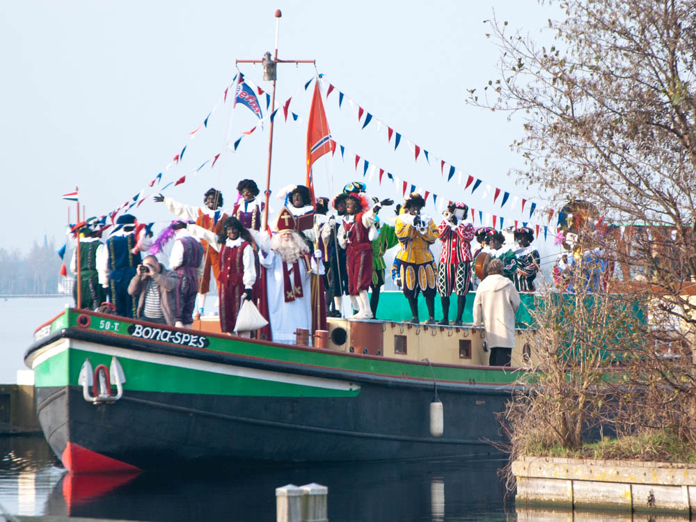 Sinterklaas and his Black Petes arriving on their steam boat