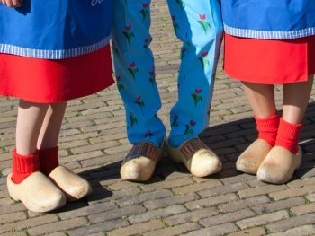 Wearing Dutch clogs together with the cheese girls in Gouda