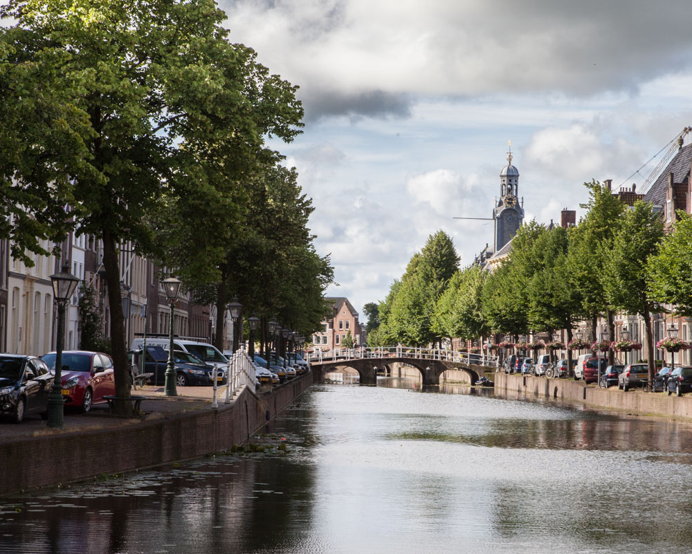 Rapenburg canal in Leiden. In the background, the university tower. The university where Rembrandt was once enrolled.