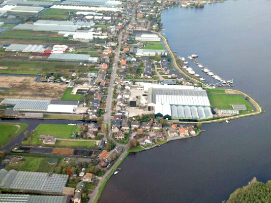 Roelofarendsveen, village in South Holland with a lake, greenhouses and flower fields