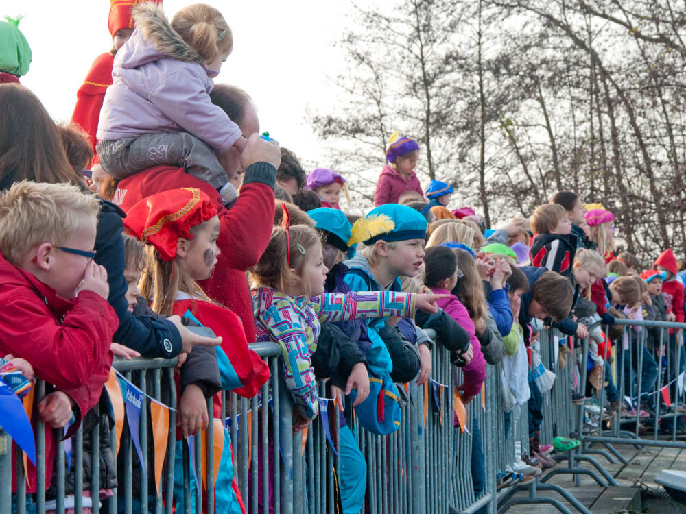 Children waiting full of excitement for the arrival of Sinterklaas and his Black Petes
