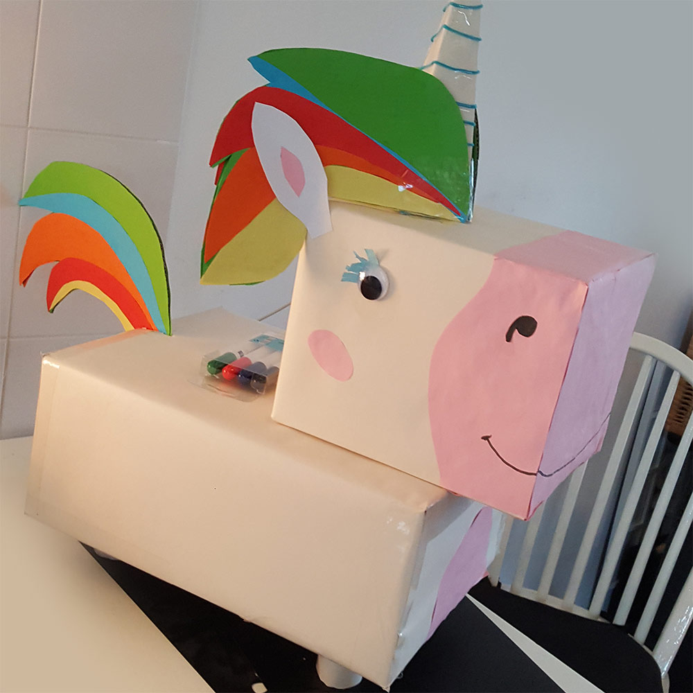 A Sinterklaas Surprise made out of cardboard boxes and paper. The girl loved the unicorn!