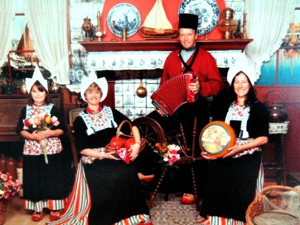 Posing in traditional Dutch dress in Volendam
