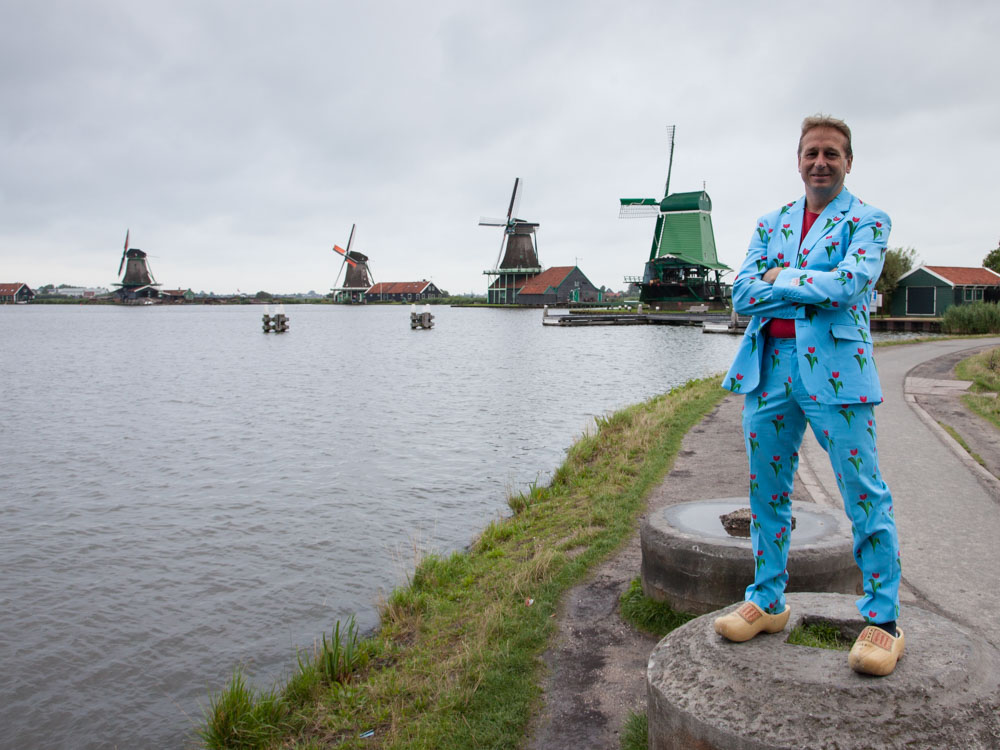 Man standing with Dutch windmills in the background